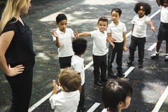 Kindergarten students standing together in a line stock photography