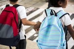 Kindergarten students walking crossing school road Royalty Free Stock Image