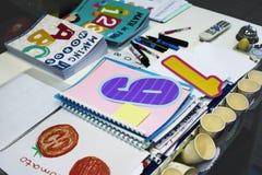 Kindergarten Students Workbooks on Teacher Table. Kindergarten students workbooks on the table Royalty Free Stock Photo