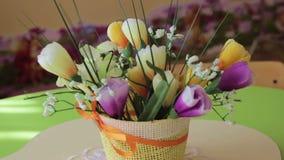 In kindergarten table  artificial flowers stock video footage