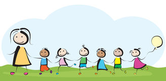 Kindergarten. A teacher is leading a group of happy little children Stock Photo