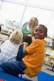 Kindergarten teacher reading to children royalty free stock photos