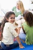 Kindergarten teacher reading to children royalty free stock image