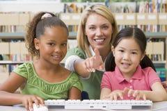 Kindergarten teacher sitting with children royalty free stock images