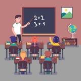 Kindergarten teacher teaching math to small pupils Royalty Free Stock Photos