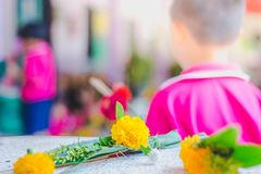 Kindergarten wait to make merit and candle light on Makha Bucha. Day Stock Images