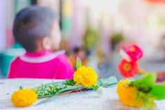 Kindergarten wait to make merit and candle light on Makha Bucha. Day Royalty Free Stock Photo
