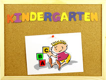 Kindergarten word on a corkboard Stock Photo