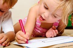 Kindergartenzeichenstiftkinder Lizenzfreie Stockbilder
