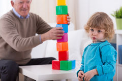 Kindergartner and colorful building blocks Stock Images