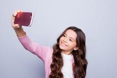 Kinderjaren, verslaving aan zelfschoten, telefoon, technologie, inter royalty-vrije stock afbeelding