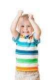 Kinderjunge mit den Händen oben lokalisiert auf Weiß Stockbilder
