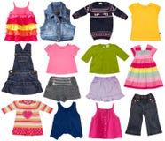 Kindermodekleidung lokalisiert auf Weiß. Lizenzfreie Stockfotos