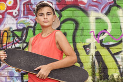 Kinderskateboardfahrerporträt Lizenzfreies Stockfoto