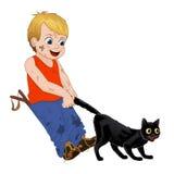 Kinderspiel draußen, netter kleiner Junge des Strolchs zieht das Endstück der schwarzen Katzen Lustige Zeichentrickfilm-Figur Vek Lizenzfreie Stockfotos
