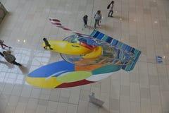 Kinderspiel mit an gemalt dem Boden Lizenzfreie Stockfotografie