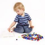 Kinderspiele mit einem Mosaik Stockbild