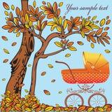 Kinderwagen op de de herfstachtergrond. Royalty-vrije Stock Afbeeldingen