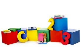 Kinderziegelsteine und -bücher. Lizenzfreie Stockfotos
