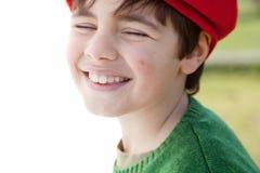 Kindglimlachen in het zonlicht Stock Foto