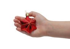 Kindhandholding-Weihnachtsdekoration Stockbild