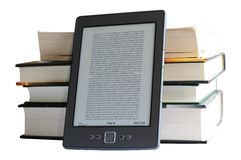 Kindle 4 with books royalty free stock image