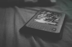 Kindle reader on bed