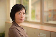 Kindly Asian woman Royalty Free Stock Images