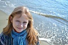 Kindly girl and shining sea Royalty Free Stock Image