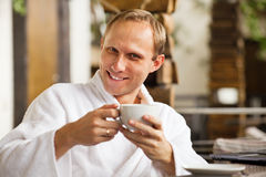 Kindly smiling man portrait with cup of morning co Stock Photography