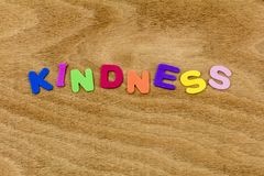 Kindness kind help charity gentle spell children letters. Kindness kind help charity be gentle spell children letters school learning plastic helping preschool stock photography
