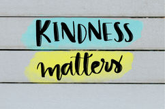 Kindness matters inspirational message. On grey wooden background Stock Photography