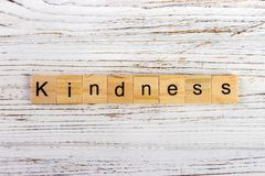 Kindness word made with wooden blocks concept.  Royalty Free Stock Images