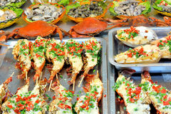 Kinds of fish and seafood for toast. Making barbecued scallop in spicy and special flavour taste, shown local aroma and different cooking or food culture as Royalty Free Stock Photos