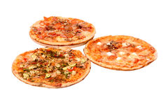 Kinds of pizza. Three different kinds of tasty pizza royalty free stock photo