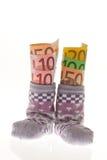 Kindsocken mit Eurobanknoten Lizenzfreies Stockfoto