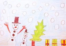 Kindtekening over Kerstmis met sneeuw stock foto's