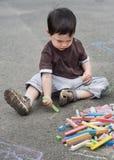 Kindzeichnung mit Kreide Lizenzfreie Stockfotos