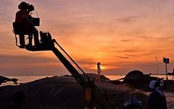 Kinematographing på solnedgång Arkivbild