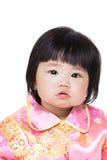 Kines behandla som ett barn flickan med den traditionella dräkten royaltyfria foton