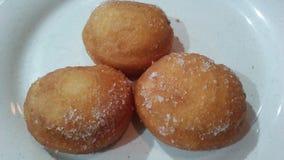 Kines Fried Donuts på plattan arkivbilder