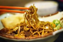 kines stekte nudlar Arkivbild