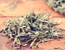 Kines tryckte på vitt te, silvervisare arkivfoton