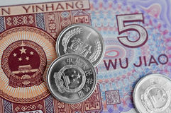 Kinesanmärkningar och mynt Arkivbilder