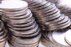 Kinesen myntar Arkivbild
