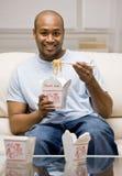 kinesen som äter den hungriga mannen för mat ut, tar Royaltyfri Fotografi