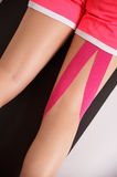 Kinesio tape on injured leg Royalty Free Stock Photography