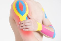 Kinesio tape, kinesiology taping on man hand. Gray background Stock Photography