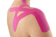 Kinesio tape on shoulder. Royalty Free Stock Image
