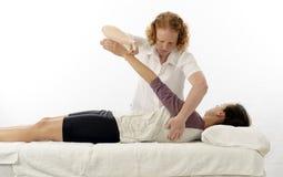 Kinesiologist treating anterior serratus. Kinesiologist or physiotherapist treating anterior serratus Royalty Free Stock Image